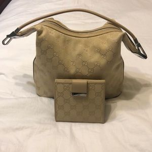 Authentic Gucci canvas bag with matching wallet.
